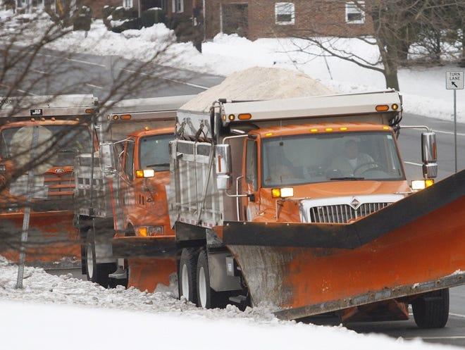 DelDOT plows sit on Limestone Road near Milltown Road Saturday morning.