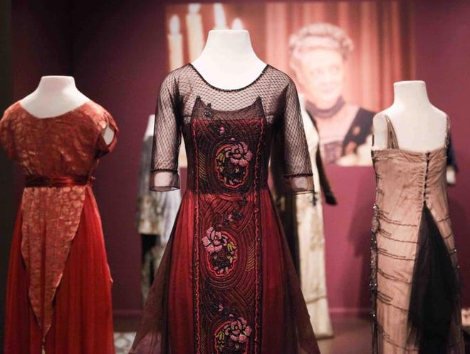 """Costumes of Downton Abbey"" immerses museum-goers in scenes from the PBS drama with photos and quotes appearing with the costumes. The exhibit is open through Jan. 4, 2015."