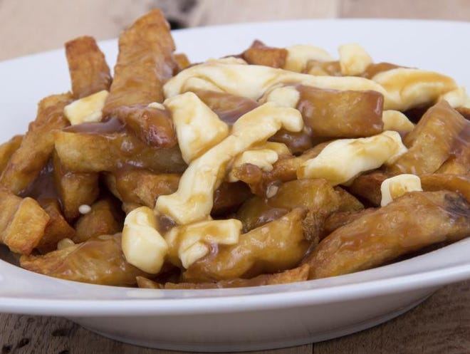 Poutine, or french fries with cheese curds and gravy, will be served this year at Harry the K's .