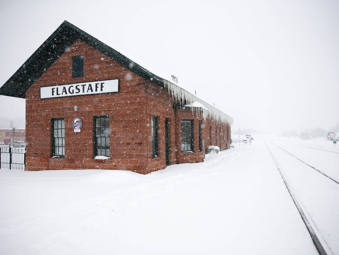 Snow falls on the train station in Flagstaff January