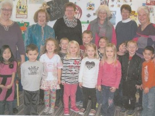 Wisconsin Bookworms readers Kay Ratajczak, Jan Zenner, Janice Gilbertson, Sheryl Rayome, Barb Hartjes and Linda Vogel are shown here with the children who benefit from the HCE reading program.
