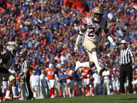 FSU's Cyrus Fagan celebrates a turnover against Florida