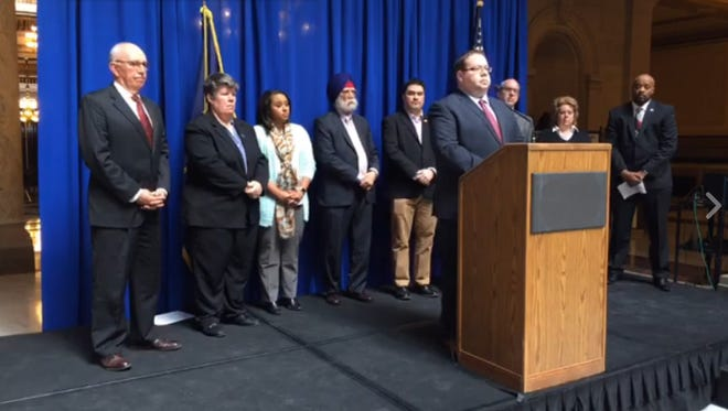 David Sklar, government affairs director with the Jewish Community Relationship Council, stands with members of a coalition of state leaders hoping to urge the Indiana General Assembly to pass a hate crimes bill in 2017.