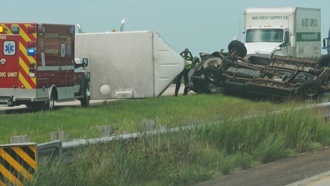 A truck pulling a trailer lost control on Interstate 70 near mile marker 242 causing all eastbound traffic to stop for miles at around 11:14 a.m. Wednesday.  Saline emergency responders found one person in the vehicle trapped and one with leg injuries.
