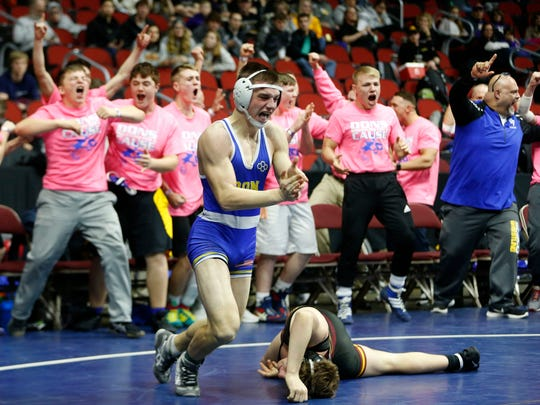 Don Bosco's Austin Hellman celebrates as he clinches the team win with his victory over Denver's John Ebaugh Wednesday, Feb. 14, 2018, at the 2018 Dual Team Wrestling championships in Des Moines.
