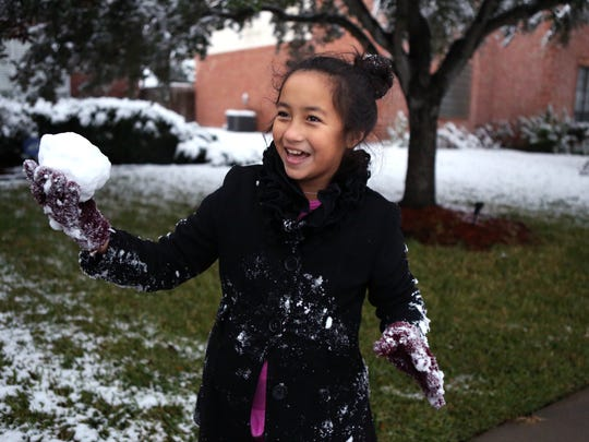 Haleigh Lopez, 10, threatens her dad with a snowball at their home on the Southside of Corpus Christi, TX, on December 8, 2017.
