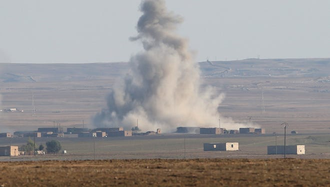 In this November 2015 file photo, an airstrike by a U.S.-led coalition warplane explodes on an ISIL position in Syria.