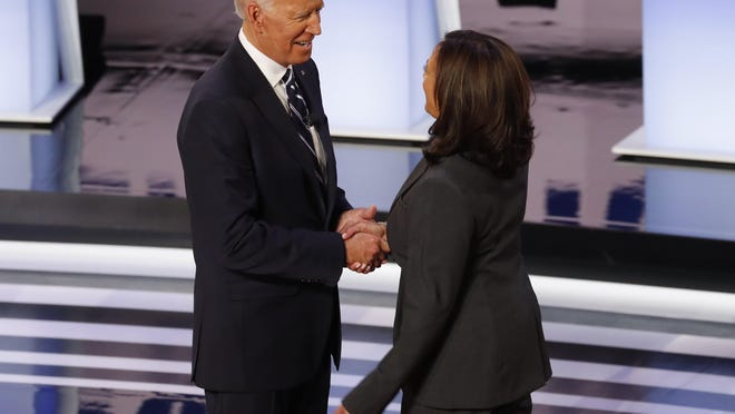 Former Vice President Joe Biden and Sen. Kamala Harris, D-Calif., shake hands before the second of two Democratic presidential primary debates hosted by CNN Wednesday, July 31, 2019, in the Fox Theatre in Detroit.