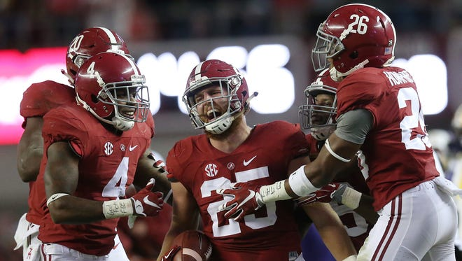 Alabama linebacker Dillon Lee (25) celebrates after picking off the ball against LSU in the second half of an NCAA college football game Saturday, Nov. 7, 2015, in Tuscaloosa , Ala. (AP Photo/John Bazemore)