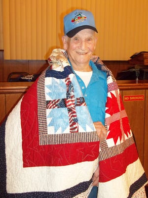 Ross Brown, US Navy, WWII submariner on the USS Flasher (SS-249) was recently awarded a Quilt of Valor by the Mountain Home Quilts of Valor, at the American Legion Post 52.  The USS Flasher was awarded the Presidential Unit Citation with six battle stars for her six war patrols.  The conning tower of the USS Flasher serves as a memorial to the 52 US submarines and their crews lost during WWII.  It is located in Groton, Conn.