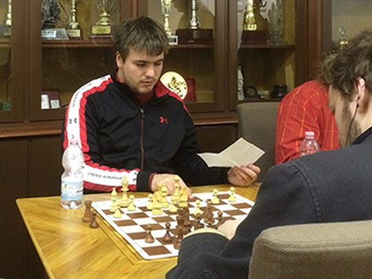 Jacob Painter, a student at Shippensburg University, analyzes a game of chess at the Hungarian Chess Federation building in Budapest, Hungary.