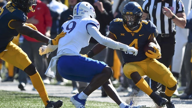 West Virginia running back Leddie Brown picks up yardage against Kansas last week in the Mountaineers' victory in Morgantown, W.Va. Brown, who's fourth nationally with 128.8 rushing yards per game, is the Big 12 offensive player of the week.