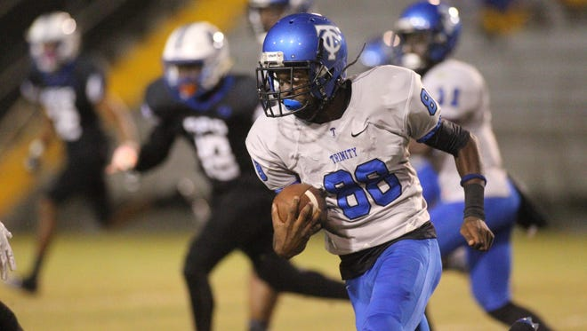 Trinity Christian's D.J. Matthews, an FSU commit, runs for a large gain during a game against Godby on Thursday night at Gene Cox Stadium.