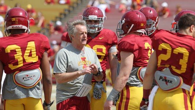 Cyclones assistant coach Stan Eggen, shown talking to his defensive ends during Iowa State's spring scrimmage in April 12, is set to welcome recruit Larry Jefferson to the Cyclone campus.