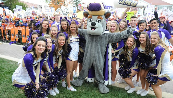 Oct 24, 2015; Harrisonburg, VA, USA; James Madison Dukes cheerleaders pose during the broadcast in the front of Wilson Hall on the campus of James Madison University prior to the homecoming game between Richmond and James Madison at Bridgeforth Stadium. Mandatory Credit: Brad Mills-USA TODAY Sports