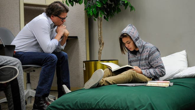 Clinical psychologist Paul Case listens to Owen Rockenbach, 15, read from his notes on disappointments at Ridgecrest Academy, Nashville's only high school for students with addictions.