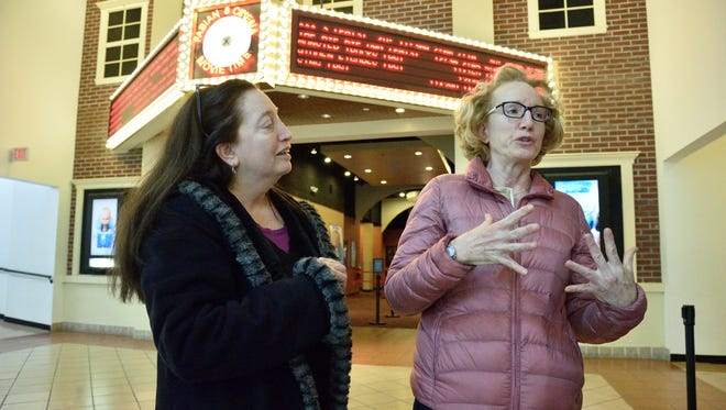 """Sisters Sharon Ferreira and Patty Brolsma, outside the Fabian 8 Cinema in Paterson. Their dad, like the protagonist in the movie """"Paterson,"""" was a bus driver from Paterson who wrote poetry."""