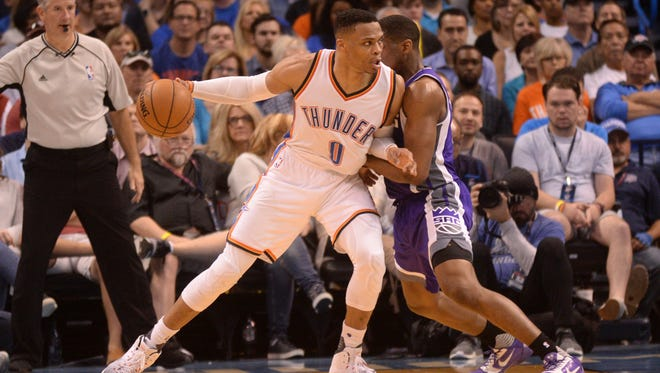 Oklahoma City Thunder guard Russell Westbrook (0) posts up against Sacramento Kings guard Darren Collison (7) during the third quarter at Chesapeake Energy Arena.