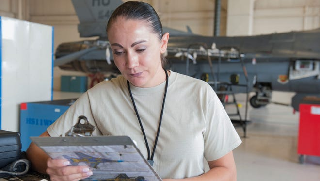 Master Sgt. Nina Brown, 54th Maintenance Squadron production superintendent, checks over a data sheet to ensure that all aircraft repairs are accounted for at Holloman Air Force Base, N.M., Aug. 23, 2017. Due to her hard work and dedication, Brown won the Air Education and Training Command 2018 National Public Service Award for her outstanding contributions to domestic violence shelters.