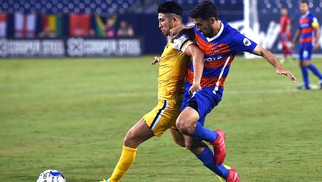 Nashville SC defender Kosuke Kimura (27) controls the ball against FC Cincinnati's Nazmi Albadawi (5) in the second period on Saturday, July 7, 2018 at Nissan Stadium in Nashville, Tenn.