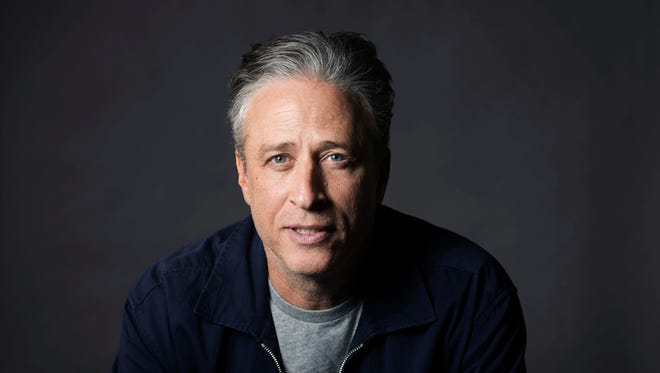 FILE - In this Nov. 7, 2014 file photo, Jon Stewart poses in New York.