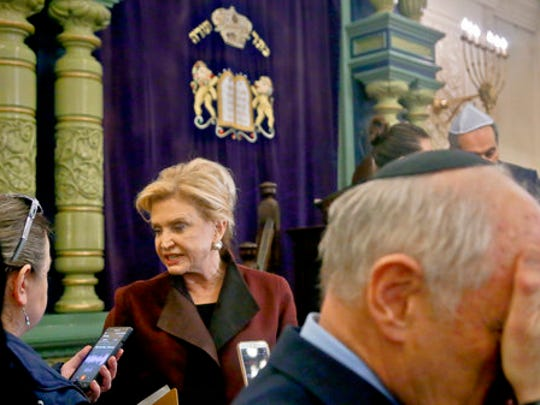 FILE - In this March 3, 2017, file photo, Congresswoman Carolyn Maloney, center, a member of Congress's bipartisan task force combating anti-Semitism, speaks with a reporter after holding a news conference to address bomb treats against Jewish organizations and vandalism at Jewish cemeteries at the Park East Synagogue in New York. Jewish groups who warned of a surge in anti-Semitism had pointed to numerous bomb threats against Jewish community centers as the most dramatic example of the trend. Now authorities say an Israeli Jewish teen is responsible, potentially undermining the community's fight against bigotry and embarrassing those who blamed a far-right emboldened by President Donald Trump.