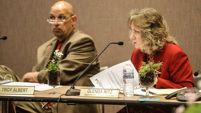 Supt.Glenda Ritz (right) listens during a Board of Education meeting Tuesday.