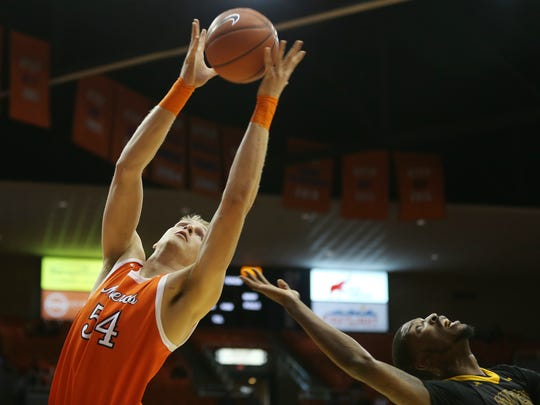 UTEP's Kelvin Jones grabs a rebound over Southern Miss'