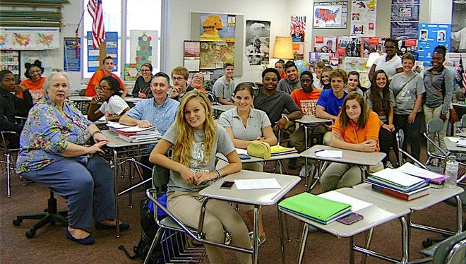 Teachers Darlene William and Robert Watson, seated at left, are joined by some of the students in Mansfield Senior High School's leadership logistics class.