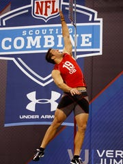 Tim Tebow performs the vertical jump during the 2010