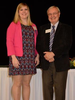 Jefferson Elementary School teacher Courtney DeArmond (left) receives a $6,000 Herb Kohl Educational Foundation 2017 Fellowship at a recognition luncheon.