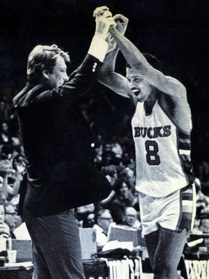 Milwaukee Bucks coach Don Nelson celebrates a play with Marques Johnson during a 1983 game.
