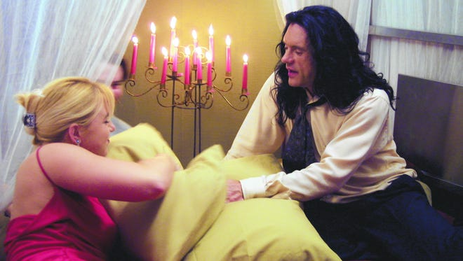 "Tommy Wiseau (right, with Juliette Danielle) wrote, directed, co-produced and stars in ""The Room,"" a meant-to-be-serious drama that is so ineptly done that it's become a midnight-movie staple."
