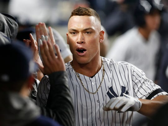 New York Yankees' Aaron Judge celebrates in the dugout