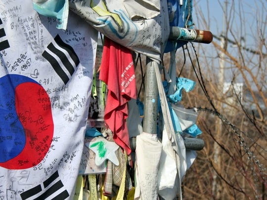 The Freedom Bridge ends with a fence of wire that is stuffed with notes of hope and reunification.
