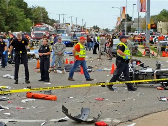 Emergency personnel respond to the scene of an accident after a vehicle crashed into a crowd of spectators during the Oklahoma State University homecoming parade, causing multiple injuries, on Saturday, Oct. 24, 2015 in Stillwater, Oka.