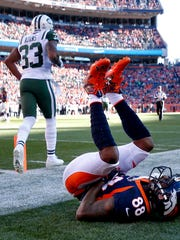 Denver Broncos wide receiver Demaryius Thomas (88) lies on the turf after a hit as New York Jets strong safety Jamal Adams (33) walks away during the first half of an NFL football game, Sunday, Dec. 10, 2017, in Denver (AP Photo/Jack Dempsey)
