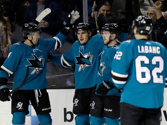 San Jose Sharks' Timo Meier, second from left, celebrates with teammates after scoring against the Chicago Blackhawks during the second period of an NHL hockey game Thursday, March 1, 2018, in San Jose, Calif. (AP Photo/Marcio Jose Sanchez)