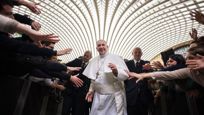Pope Francis arrives for a special audience with members of the dioceses of Cassano allo Jonio, southern Italy, at the Vatican on Feb. 21.