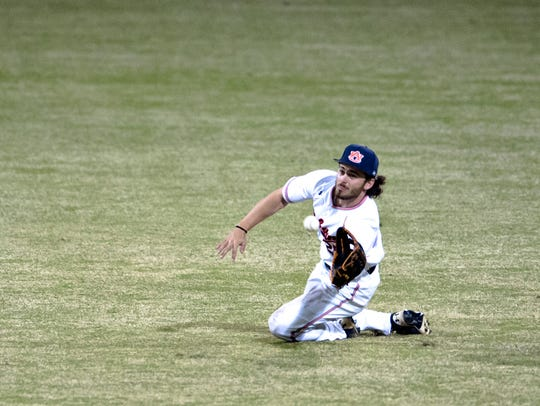 Auburn outfielder Jay Estes catches a line drive during