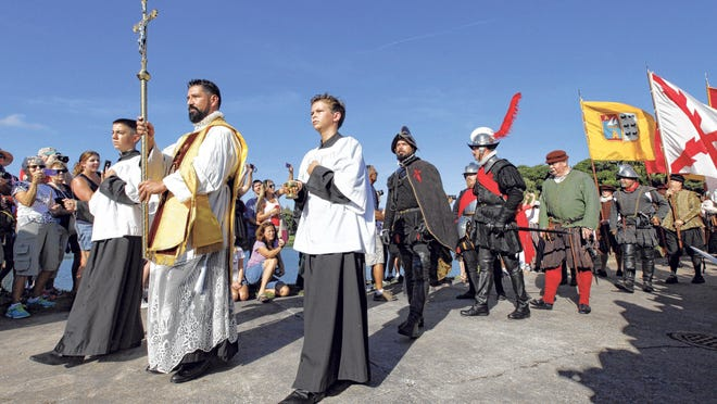 in this St. Augustine Record file photo, Pedro Menendez de Aviles, center, portrayed by Chad Light, parades through the grounds of the Mission Nombre de Dios during a re-enactment of the 1565 landing.