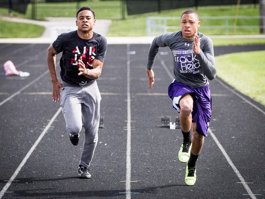 Eliyahu and Eliseus Young take off running down Central's track during practice on Monday. The fraternal twins will try to bring home a win for Central on Thursday.