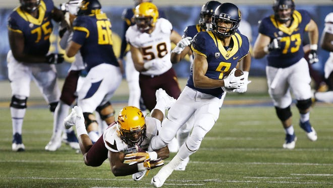 Arizona State's Kweishi Brown (10) drives and misses the tackle on Cal wide receiver Trevor Davis (9) in the first half on Nov. 28, 2015 in Berkeley, Calif.