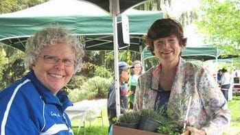 Master Gardener Ann Cusack (left) rings up a sale for Freeholder Bette Jane Kowalski at the 2014 Rutgers Master Gardeners of Union County Spring Garden Fair and Plant Sale.