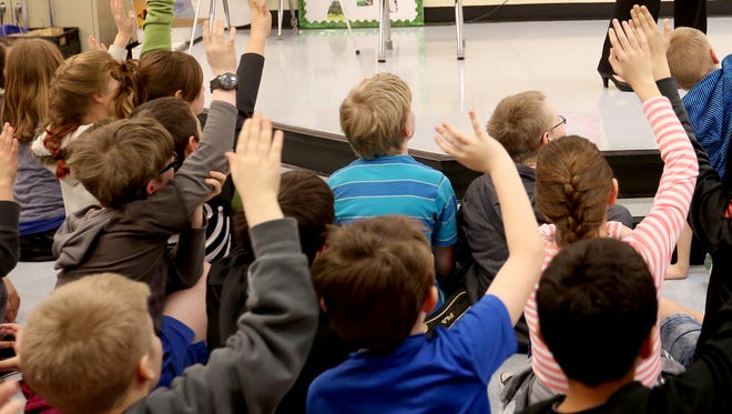 Students answer questions following a presentation at Myers Elementary School in West Salem on Tuesday, March 8, 2016.