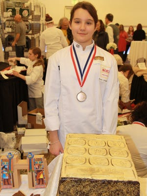 """Dora Ivkovich, 10, an eighth grader at Chippewa Middle School in Okemos, took third place in the cakes and tortes category with her entry """"The Torte of Ahkmenrah"""" at the MSU Museum Chocolate Party benefit."""