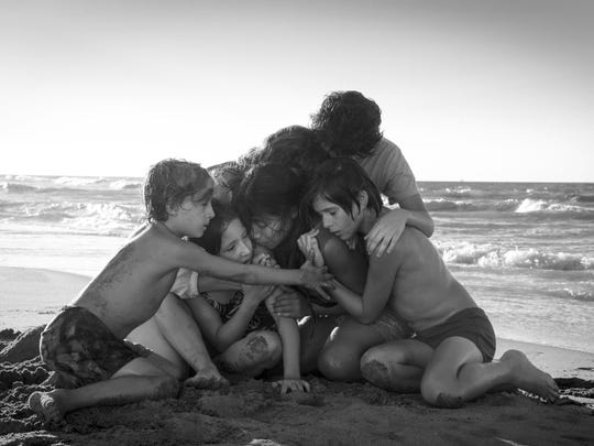 "Yalitza Aparicio, center, appears in a scene from the film ""Roma,"" by filmmaker Alfonso Cuaron. The film is nominated for an Oscar for both best foreign language film and best picture. The 91st Academy Awards will be held on Sunday."