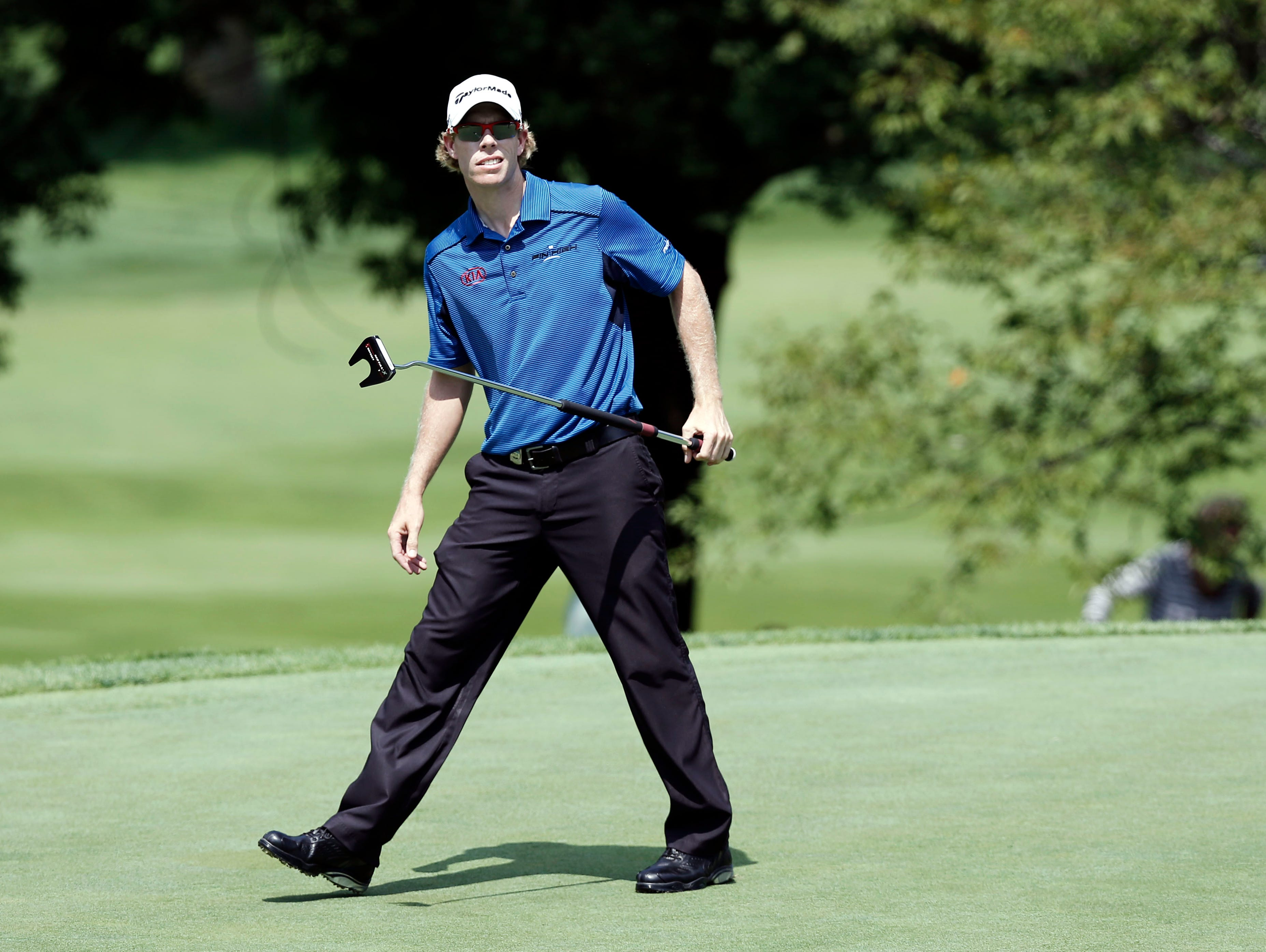 David Hearn reacts to his putt on the 17th green during the first round of the 95th PGA Championship at Oak Hill Country Club.