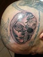 Ernesto Hernandez' tattoos.