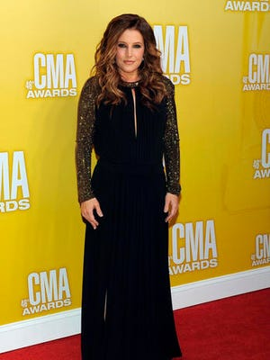 FILE - In this Thursday, Nov. 1, 2012, file photo, Lisa Marie Presley arrives at the 46th Annual Country Music Awards at the Bridgestone Arena in Nashville, Tenn. A Los Angeles judge on Wednesday, Feb. 22, 2017, ruled that Presley must pay $50,000 to her estranged husband's attorney in their messy divorce case, but that she does not have to pay him spousal support until other issues in the case are resolved.